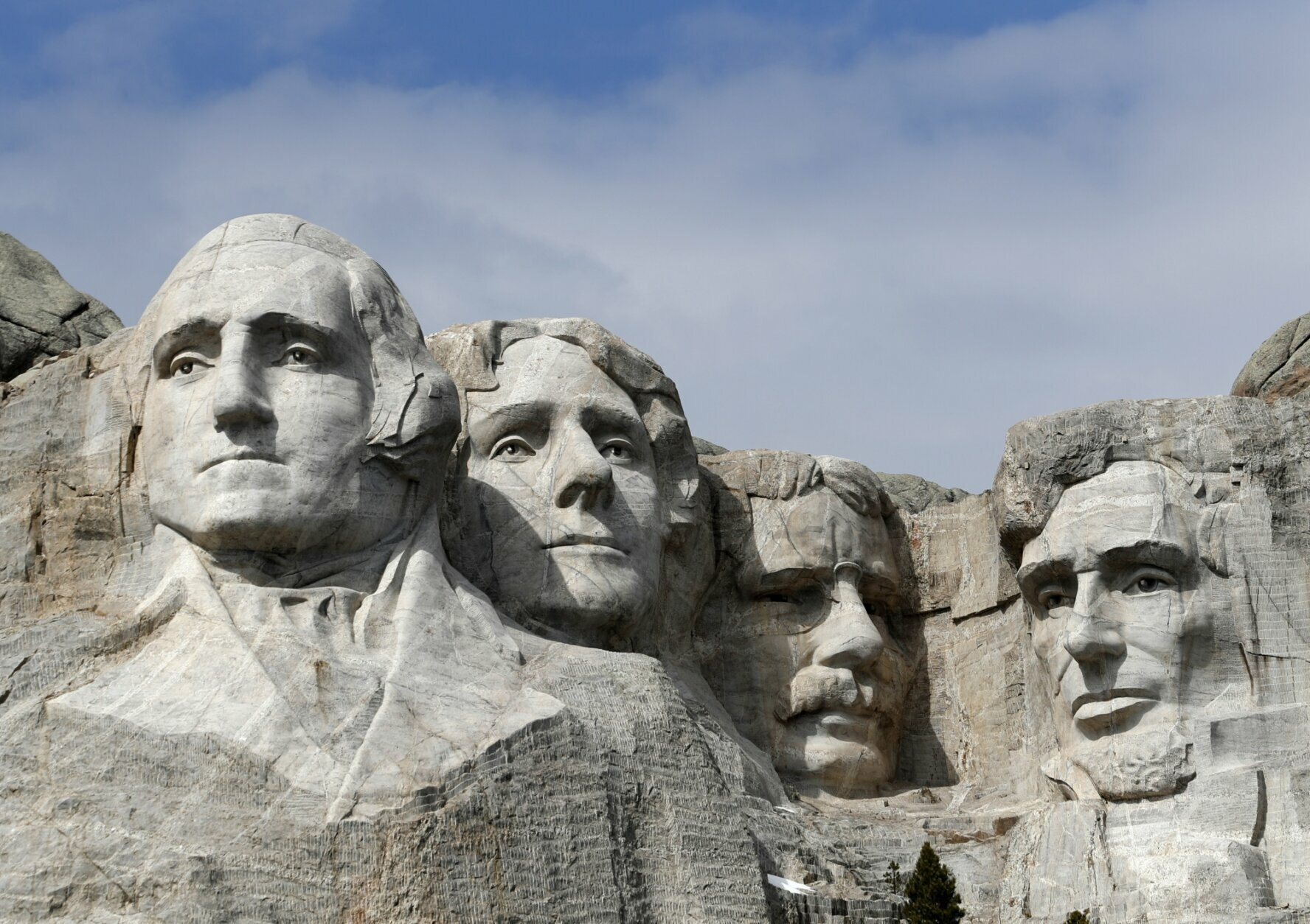 FILE - This March 22, 2019, file photo shows Mount Rushmore in Keystone, S.D. President Donald Trump will begin his Independence Day weekend on Friday with a patriotic display of fireworks at Mount Rushmore National Memorial before a crowd of thousands. (AP Photo/David Zalubowski, File)