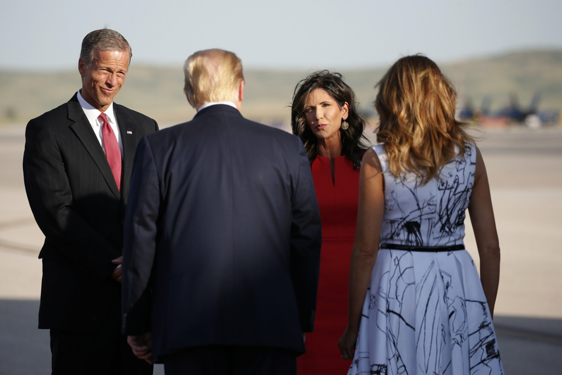 Sen. John Thune, R-S.D., and Gov. Kristi Noem greet President Donald Trump and first Lady Melania Trump upon arrival at Ellsworth Air Force Base, Friday, July 3, 2020, in Rapid City, S.D. Trump is en route to Mount Rushmore National Memorial. (AP Photo/Alex Brandon)