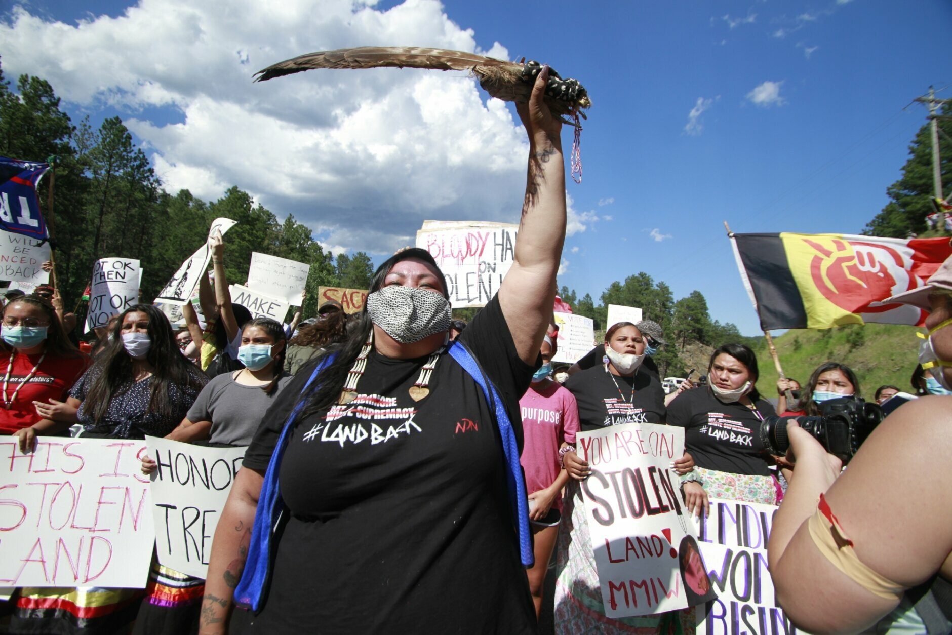 Native American protesters demonstrate in Keystone, S.D., ahead of President Donald Trump's visit to the memorial Friday, July 3, 2020. Protesters are advocating for the Black Hills to be returned to the Lakota people. (AP Photo/Stephen Groves)