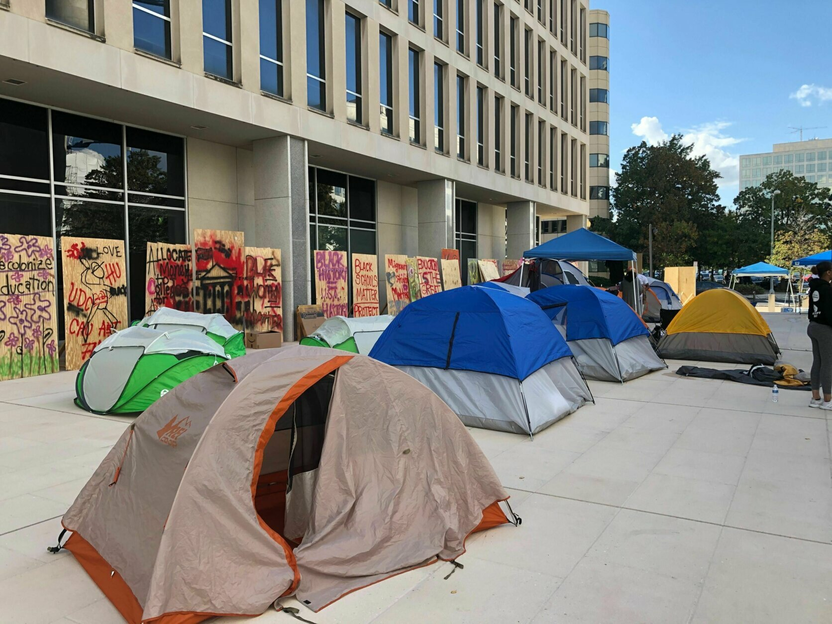 About 15 tents have been pitched outside the Department of Education building in D.C., where protestors are demanding changes to make our education system more equitable.