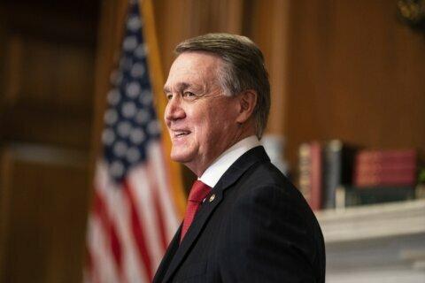 Familiar refrain by Perdue, Ossoff in Georgia Senate debate