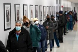 People line up to vote at a polling place inside the Bartow Community Center, Tuesday, Nov. 3, 2020, in the Bronx borough of New York. (AP Photo/Mark Lennihan)