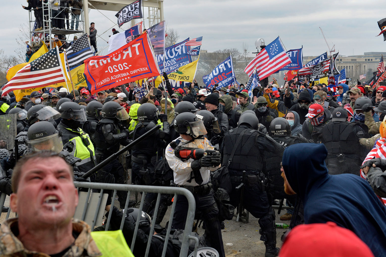 Trump supporters clash with police and security forces as people try to storm the US Capitol Building in Washington, DC, on January 6, 2021. - Demonstrators breeched security and entered the Capitol as Congress debated the a 2020 presidential election Electoral Vote Certification. (Photo by Joseph Prezioso / AFP) (Photo by JOSEPH PREZIOSO/AFP via Getty Images)