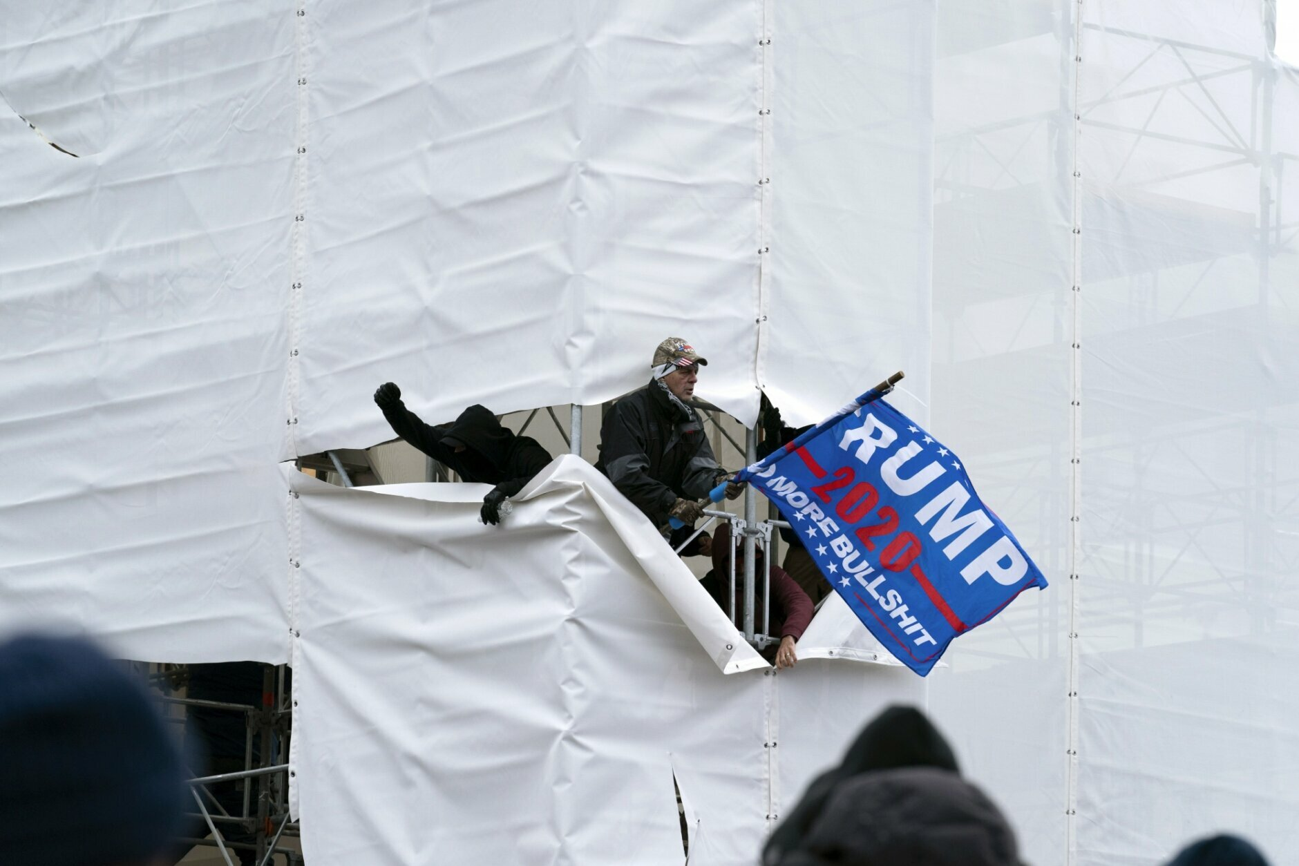Trump supporters gather outside the Capitol, Wednesday, Jan. 6, 2021, in Washington. As Congress prepares to affirm President-elect Joe Biden's victory, thousands of people have gathered to show their support for President Donald Trump and his claims of election fraud. (AP Photo/Jose Luis Magana)