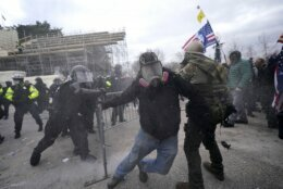Trump supporters try to break through a police barrier, Wednesday, Jan. 6, 2021, at the Capitol in Washington. As Congress prepares to affirm President-elect Joe Biden's victory, thousands of people have gathered to show their support for President Donald Trump and his claims of election fraud. (AP Photo/Julio Cortez)