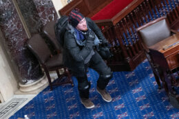 WASHINGTON, DC - JANUARY 06: A protester supporting U.S. President Donald Trump  moves to the floor of the Senate chamber at the U.S. Capitol Building on January 06, 2021 in Washington, DC. Congress held a joint session today to ratify President-elect Joe Biden's 306-232 Electoral College win over President Donald Trump. A group of Republican senators said they would reject the Electoral College votes of several states unless Congress appointed a commission to audit the election results (Photo by Win McNamee/Getty Images)