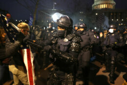 WASHINGTON, DC - JANUARY 06: Police officers in riot gear confront  protesters who are gathering at the U.S. Capitol Building on January 06, 2021 in Washington, DC. Pro-Trump protesters entered the U.S. Capitol building after mass demonstrations in the nation's capital during a joint session Congress to ratify President-elect Joe Biden's 306-232 Electoral College win over President Donald Trump. (Photo by Tasos Katopodis/Getty Images)