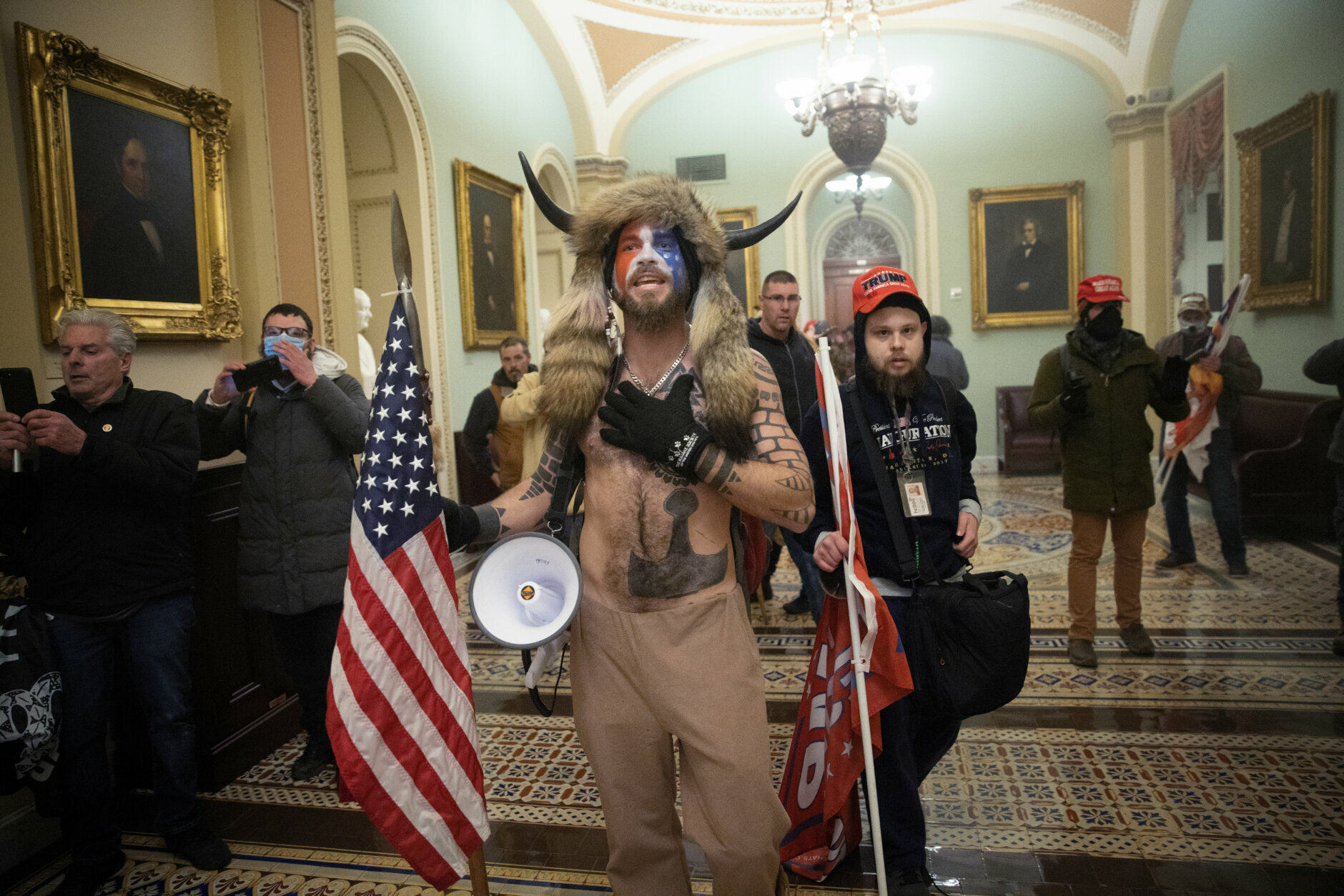 WASHINGTON, DC - JANUARY 06:  A pro-Trump mob confronts U.S. Capitol police outside the Senate chamber of the U.S. Capitol Building on January 06, 2021 in Washington, DC. Congress held a joint session today to ratify President-elect Joe Biden's 306-232 Electoral College win over President Donald Trump. A group of Republican senators said they would reject the Electoral College votes of several states unless Congress appointed a commission to audit the election results. (Photo by Win McNamee/Getty Images)