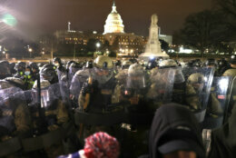 WASHINGTON, DC - JANUARY 06: Members of the National Guard assist police officers in dispersing protesters who are gathering at the U.S. Capitol Building on January 06, 2021 in Washington, DC. Pro-Trump protesters entered the U.S. Capitol building after mass demonstrations in the nation's capital during a joint session Congress to ratify President-elect Joe Biden's 306-232 Electoral College win over President Donald Trump. (Photo by Tasos Katopodis/Getty Images)