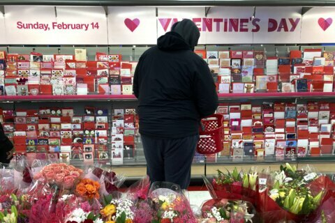 A bleak Valentine's Day, lovers find hope in roses, vaccines