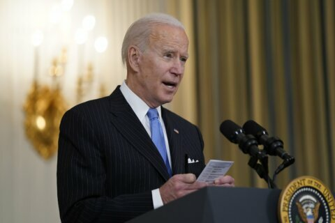 Analysis: Biden aims to manage expectations with pandemic
