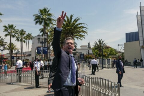 Cash payments take center stage in Newsom's 1st recall ad