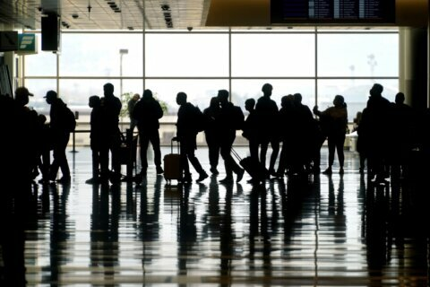 Business travel stirs, but many road warriors stay grounded