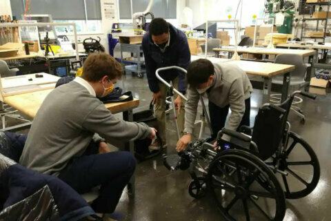 Maryland students build device allowing people in wheelchairs to walk their babies