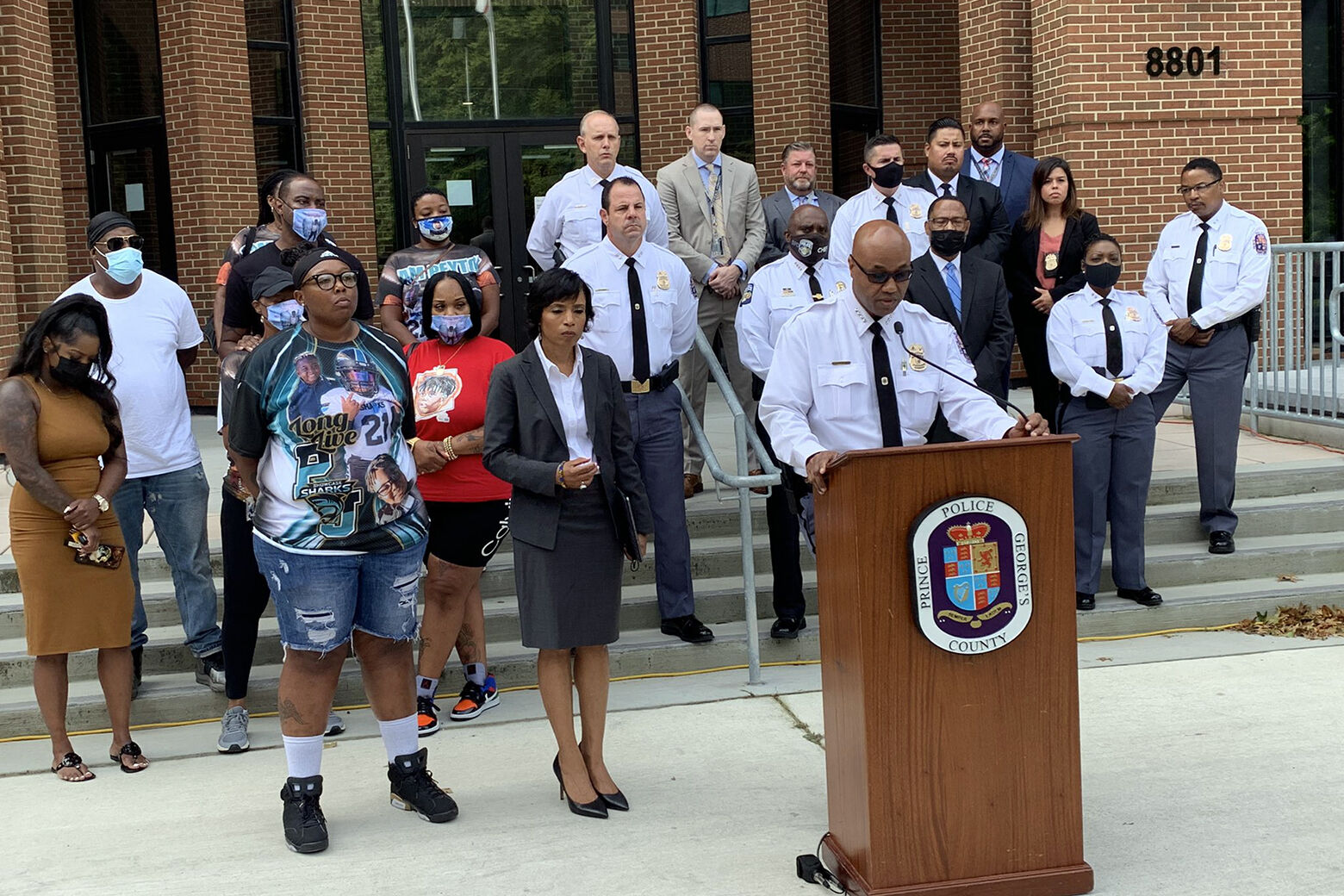 Mother of slain 8-year-old gets 'a gift' — suspects' handcuffs