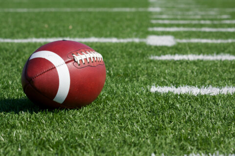 Woodbridge HS football coach dies after collapsing during game