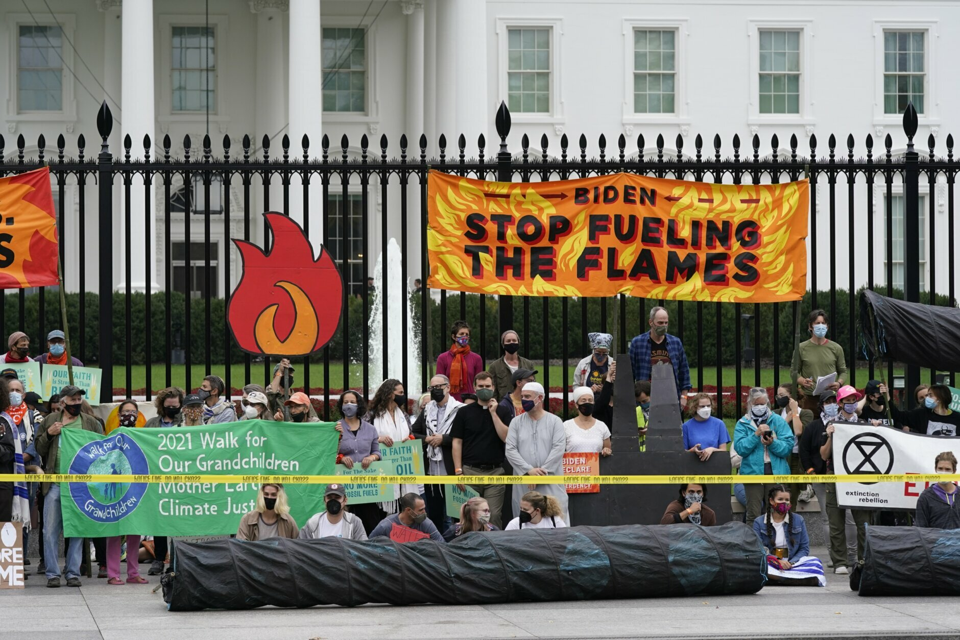 Protesters gather to urge the Biden administration to do more to combat climate change and ban fossil fuels outside the White House in Washington on Tuesday, October 12, 2021. (AP Photo / Patrick Semansky)