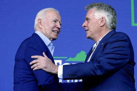 Biden ties Republican in race for Va. governor to Trump, campaigns for McAuliffe